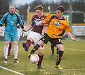 Stenny's Robbie Duncan clears from Alloa's Kevin Cawley.