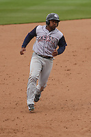 Colorado Springs Sky Sox infielder Chris Nelson (15) rounds the bases during a Pacific Coast League game against the Iowa Cubs on May 11th, 2015 at Principal Park in Des Moines, Iowa.  Colorado Springs defeated Iowa 13-7.  (Brad Krause/Four Seam Images)