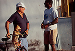 Cuba, Havana, Veradero Beach, Lifestyle, Men talking, dog hanging, and yes they do look alike, Gulf of Mexico, Caribbean Sea, Central America.