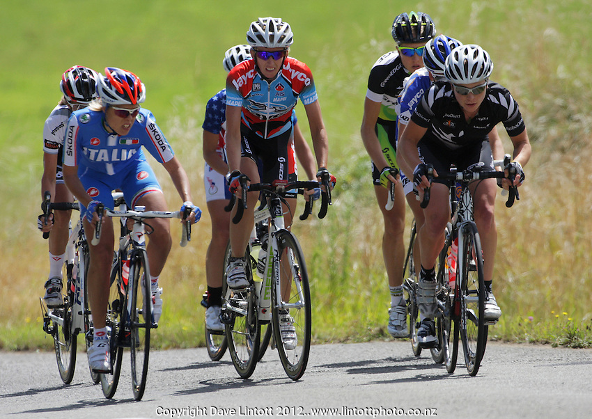 The peloton chases the lead pair during the NZCT Women's Cycle Tour of New Zealand Stage 4 at Palmerston North, New Zealand on Saturday, 25 February 2012. Photo: Dave Lintott / lintottphoto.co.nz