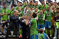 SEATTLE, WA - NOVEMBER 10: MLS Commissioner Don Garber presents the 2019 MLS Cup to Seattle Sounders midfielder Nicolas Lodeiro #10 during a game between Toronto FC and Seattle Sounders FC at CenturyLink Field on November 10, 2019 in Seattle, Washington.