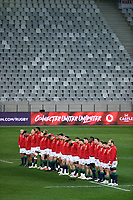 British & Irish Lions players line up for the national anthem.<br /> South Africa v British & Irish Lions, 1st Test, Cape Town Stadium, Cape Town, South Africa,  Saturday 24th July 2021. <br /> Please credit: FOTOSPORT/DAVID GIBSON