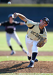 UC Davis' Patrick Hennessey pitches in a college baseball game between the Washington Huskies and the UC Davis Aggies in Davis, Ca., on Sunday, Feb. 17, 2013. Davis won 7-5 to finish their season opening series 3-1. .Photo by Cathleen Allison