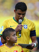 Thiago Silva of Brazil reads out a FIFA anti racism message before kick off