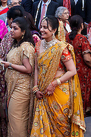 Jaipur, Rajasthan, India.  Indian Ladies in Saris and Jewelry Arriving at a Wedding Reception.  Note Henna Decoration on Hands.