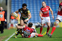 Ken Pisi of Northampton Saints is tackled by Seb Stegmann of London Welsh during the Aviva Premiership match between London Welsh and Northampton Saints at the Kassam Stadium on Sunday 14th April 2013 (Photo by Rob Munro)