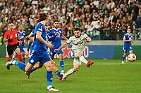 30th September 2021; Marshall Józef Piłsudski's Municipal Stadium, Warsaw, Poland: Europa League fooball, Legia Warsaw versus Leicester City;  BARTOSZ SLISZ shoots past CAGLAR SOYUNCU