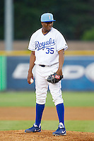 Burlington Royals relief pitcher Robinson Yambati (35) looks to his catcher for the sign against the Princeton Rays at Burlington Athletic Park on July 11, 2014 in Burlington, North Carolina.  The Rays defeated the Royals 5-3.  (Brian Westerholt/Four Seam Images)