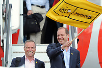 Picture by Simon Wilkinson/SWpix.com - 30/06/2014 - Cycling - 2014 Tour de France: Grand Depart - Leeds Bradford International Airport, Yorkshire, England - Tour de France director Christian Prudhomme (right) and cycling legend Bernard Hinault (left) arrive in Yorkshire, UK on a Jet2.com plane from Paris for the Tour de France Grand Depart which begins in Leeds on Saturday 5th of July. COPYRIGHT WARNING : THIS IMAGE IS RIGHTS MANAGED AND THE COPYRIGHT MAY SIT WITH A THIRD PARTY PLEASE CONTACT simon@swpix.com BEFORE DOWNLOAD AND OR USE
