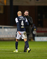 27th March 2021; Dens Park, Dundee, Scotland; Scottish Championship Football, Dundee FC versus Dunfermline; Dundee manager James McPake shakes hands with Liam Fontaine at the end of the match
