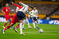 13th October 2020; Molineux Stadium, Wolverhampton, West Midlands, England; UEFA Under 21 European Championship Qualifiers, Group Three, England Under 21 versus Turkey Under 21; Maximillian Aarons of England crossing the ball under pressure from Huseyin Turkmen of Turkey