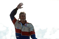 Marc Theoret waves to fans as he retires from hydroplane racing.