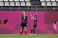 KASHIMA, JAPAN - AUGUST 5: Carli Lloyd celebrates scoring with teammates during a game between Australia and USWNT at Kashima Soccer Stadium on August 5, 2021 in Kashima, Japan.
