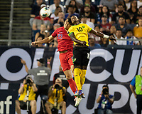 NASHVILLE, TN - JULY 3: Aaron Long #23 and Darren Mattocks #10 vie for a header during a game between Jamaica and USMNT at Nissan Stadium on July 3, 2019 in Nashville, Tennessee.