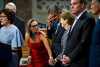 United States Senator Kyrsten Sinema (Democrat of Arizona), left, reaches out to hold the hand of United States Senator Jeanne Shaheen (Democrat of New Hampshire) while United States Senator Susan Collins (Republican of Maine), left, makes remarks after the vote on the motion to invoke cloture to proceed to the consideration of H.R. 3684, the INVEST in America Act on Capitol Hill in Washington, DC on Wednesday, July 28, 2021. The vote to begin discussion of the bipartisan infrastructure bill agreed to by the White House, was 67 to 32. If passed, the bill would invest close to $1 trillion in roads, bridges, ports and other infrastructure without a major tax increase.<br /> Credit: Rod Lamkey / CNP / MediaPunch