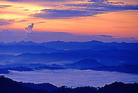 Sunrise view and the clouds covering the valleys from Mt Kota Kinabalu, Malaysia