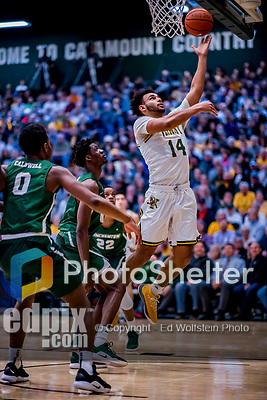 12 March 2019: University of Vermont Catamount Forward Isaiah Moll, a Freshman from Albany, NY, in action against the Binghamton University Bearcats at Patrick Gymnasium in Burlington, Vermont. The top-seeded Catamounts advanced to their fourth-straight America East conference championship game, defeating the Bearcats 84-51. Mandatory Credit: Ed Wolfstein Photo *** RAW (NEF) Image File Available ***