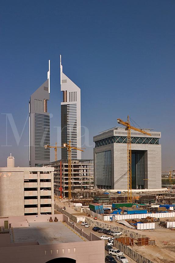 Dubai, United Arab Emirates.  Construction adjacent to Abu Dhabi Road and Emirates Towers in background. .