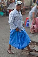 Myanmar, Burma, Yangon.  Burmese Man Wearing a Longyi, the Burmese Sarong.