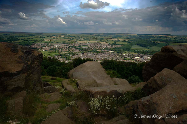 Millstone grit boulders on the summit of Otley Chevin. The painter, J M W Turner used The Chevin as a model for the mountain and cloudscape in the painting 'Hannibal crossing the Alps'. The town of Otley is the birthplace of Thomas Chippendale, furniture designer & cabinet maker.