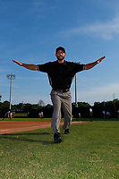 Umpire Jesse Osborne, posing for a photo signaling safe, before a Collegiate Summer League game  between the Macon Bacon and Savannah Bananas on July 15, 2020 at Grayson Stadium in Savannah, Georgia.  (Mike Janes/Four Seam Images)