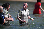 Storey County Sheriff Gerald Antinoro joins hundreds of plungers in the South Lake Tahoe Polar Plunge at Zephyr Cove, Nev., on Saturday, March 21, 2015. <br /> Photo by Cathleen Allison