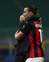 Calcio, Serie A: Inter Milano - AC Milan , Giuseppe Meazza (San Siro) stadium, in Milan, October 17, 2020.<br /> Milan's Zlatan Ibrahimovic (r) celebrates with his coach Stefano Pioli (l) after winning 2-1 the Italian Serie A football match between Inter and Milan at Giuseppe Meazza (San Siro) stadium, October 17, 2020.<br /> UPDATE IMAGES PRESS/Isabella Bonotto