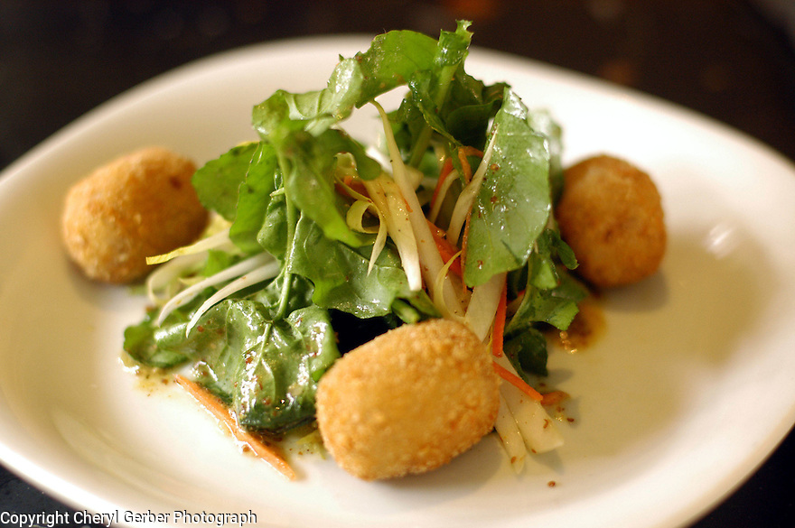 Arugula salad with rabbit croquettes is served at Herbsaint in New Orleans, Thursday, January 27, 2005..(CHERYL GERBER PHOTO).
