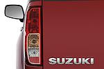 Tail light close up detail view of a 2009 suzuki equator rmz4 crew cab