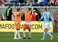 Sky Blue FC midfielder Kelly Parker (7) and defender Julianne Sitch celebrate after the Sky Blue FC victory as Chicago Red Star midfielder Lindsay Tarpley (5) walks off the field.  The Sky Blue FC defeated the Chicago Red Stars 2-0 at Toyota Park in Bridgeview, IL on May 10, 2009.