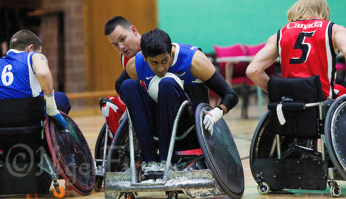 15 AUG 2011 - LEEDS, GBR - Great Britain's Mandip Sehmi looks for a way past Canada's Garett Hickling during the wheelchair rugby exhibition match between Great Britain and Canada .(PHOTO (C) NIGEL FARROW)