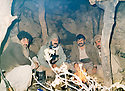 Iraq 198?. 2nd right, Azad Sagerma with peshmergas in a cave used as a shelter on Sira Merg mountain.Irak 198?.2eme a droite Azad Sagerma avec des peshmergas dans une grotte servant d'abri ,  mont Sira Meg