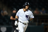 Jose Rodriguez (24) of the Winston-Salem Dash hustles down the first base line against the Greensboro Grasshoppers at Truist Stadium on August 11, 2021 in Winston-Salem, North Carolina. (Brian Westerholt/Four Seam Images)