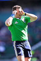 Referee Nigel Owens talks to the TMO to see whether to award a try to Owen Farrell of Saracens during the Heineken Cup semi-final match between Saracens and ASM Clermont Auvergne at Twickenham Stadium on Saturday 26th April 2014 (Photo by Rob Munro)