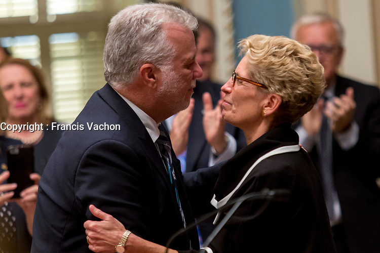 Ontario Premier Kathleen Wynne kisses Quebec Premier Philippe Couillard at the National Assembly in Quebec City September 21, 2017.<br /> <br /> PHOTO :  Francis Vachon - Agence Quebec Presse