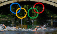 09 AUG 2012 - LONDON, GBR - Competitors pass the Olympic Rings hanging from the Serpentine Bridge during the London 2012 Olympic Games women's 10km Marathon Swimming in Hyde Park, London, Great Britain (PHOTO (C) 2012 NIGEL FARROW)