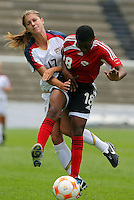 Alex Morgan of USA (L) and Jannelle Cunningham of Trinidad and Tobago (R) fight for the ball during CONCACAF U-20 Women's World Cup qualifying tournament in Puebla, Mexico. The USA defeated Trinidad and Tobago, 4-0.