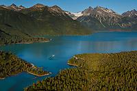Floatplane taxis on Crescent Lake in Lake Clark National Park .  Alaska Range.  early fall landscape.