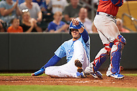 Omaha Storm Chasers Nick Pratto (32) slides safely across home plate during a game against the Iowa Cubs on August 14, 2021 at Werner Park in Omaha, Nebraska. Omaha defeated Iowa 6-2. (Zachary Lucy/Four Seam Images)