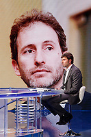 Former deputy of Movement 5 Stars and writer Alessandro Di Battista appears as a guest on the talk show Porta a Porta to present his new book 'Contro'. In the background, on the screen, Davide Casaleggio.<br /> Rome (Italy), May 25th 2021<br /> Photo Samantha Zucchi Insidefoto