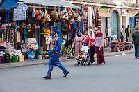 Essaouira, Morocco.  Women and Young Man Walking in Avenue de l'Istiqlal.