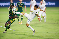 CARSON, CA - OCTOBER 07: Cristian Pavon #10 of the Los Angeles Galaxy reaches for a ball during a game between Portland Timbers and Los Angeles Galaxy at Dignity Heath Sports Park on October 07, 2020 in Carson, California.