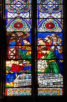 Medieval Gothic stained glass window showing  scenes from the Martyrdom of Saint Denis. In this scene St Denis is being laid in a sarcophagus. The  Cathedral Basilica of Saint Denis ( Basilique Saint-Denis ) Paris, France. A UNESCO World Heritage Site.. The Gothic Cathedral Basilica of Saint Denis ( Basilique Saint-Denis ) Paris, France. A UNESCO World Heritage Site.. The Gothic Cathedral Basilica of Saint Denis ( Basilique Saint-Denis ) Paris, France. A UNESCO World Heritage Site.