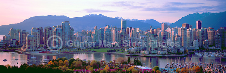 """City of Vancouver Skyline and Downtown at Yaletown and """"False Creek"""", British Columbia, Canada, in Spring, at Sunset.  The North Shore Mountains (Coast Mountains) rise above the City. - Panoramic View"""