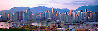 "City of Vancouver Skyline and Downtown at Yaletown and ""False Creek"", British Columbia, Canada, in Spring, at Sunset.  The North Shore Mountains (Coast Mountains) rise above the City. - Panoramic View"