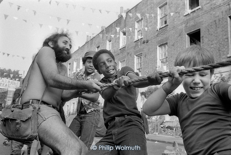 Tug-of-War, Carol Street Carnival 1982, put on by residents in a row of squatted houses in Camden Town, London, which was later granted short-life status and subsequently became a council-supported housing co-operative.