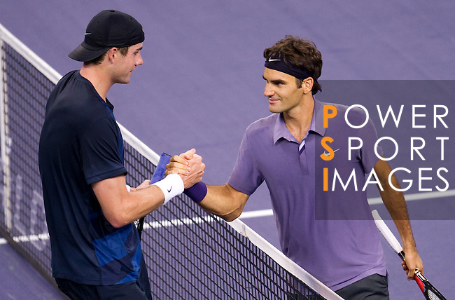 SHANGHAI, CHINA - OCTOBER 13:  Roger Federer of Switzerland shakes hand with John Isner of USA after their match during day three of the 2010 Shanghai Rolex Masters at the Shanghai Qi Zhong Tennis Center on October 13, 2010 in Shanghai, China.  (Photo by Victor Fraile/The Power of Sport Images) *** Local Caption *** Roger Federer; John Isner