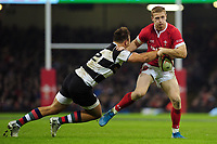 Wales Johnny Mcnicholl is tackled by Barbarians Andre Esterhuizen during the International friendly match between Wales and Barbarians at the Principality Stadium in Cardiff, Wales, UK. Saturday 30 November 2019.