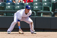 Round Rock Express first baseman Chris McGuiness #21 on defense against the New Orleans Zephyrs in the Pacific Coast League baseball game on April 21, 2013 at the Dell Diamond in Round Rock, Texas. Round Rock defeated New Orleans 7-1. (Andrew Woolley/Four Seam Images).