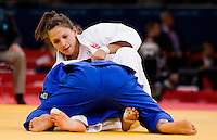 29 JUL 2012 - LONDON, GBR - Marie Muller (LUX) (top) of Luxembourg tries to overpower Christianne Legentil (MRI) of Mauritius during their women's -52kg category repechage contest in the London 2012 Olympic Games judo at the ExCel Exhibition Centre in London, Great Britain (PHOTO (C) 2012 NIGEL FARROW)
